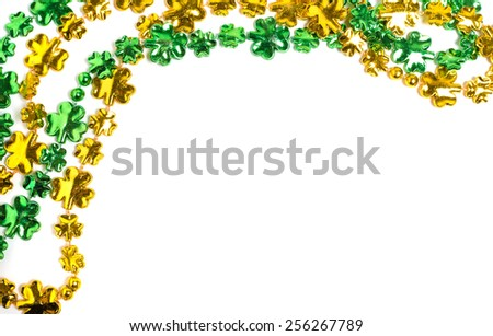 St. Patricks day beads on a white backgound with copy space - stock photo
