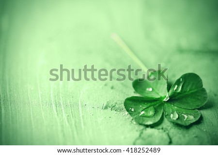 St. Patricks day,  clover leaf on green wooden background - stock photo