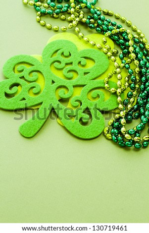 St. Patricks Day doilies on green background.