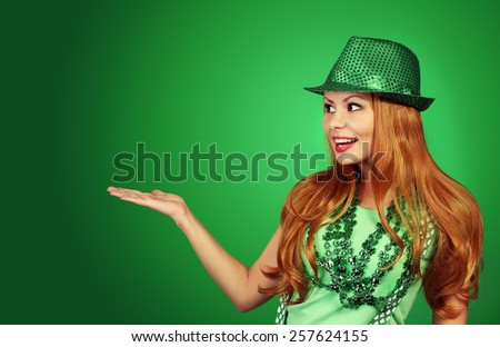 St Patricks day Girl. Cheerful young woman wearing green hat  - stock photo