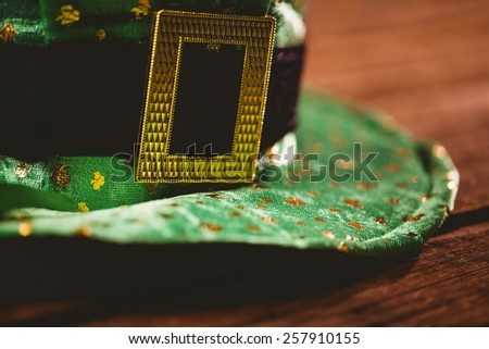 St patricks day hat on wooden table - stock photo