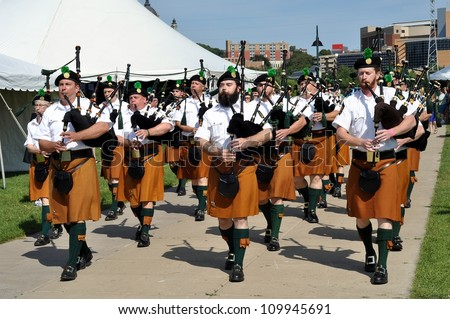 ST. PAUL - AUGUST 11:  Bagpipers entertain the crowd at the Minnesota Irish Festival on August 11, 2012, in St. Paul, Minnesota. - stock photo
