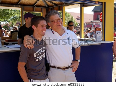 ST. PAUL - AUGUST 28:  U.S. Senator Al Franken greets a constituent at the Minnesota State Fair on August, 28, 2010 in St. Paul.