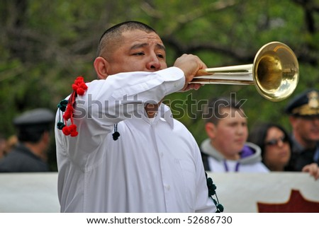 ST. PAUL- MAY 7:  A Musician performs at the Cinco de Mayo parade on May 7,2010 in St. Paul, Minnesota. - stock photo