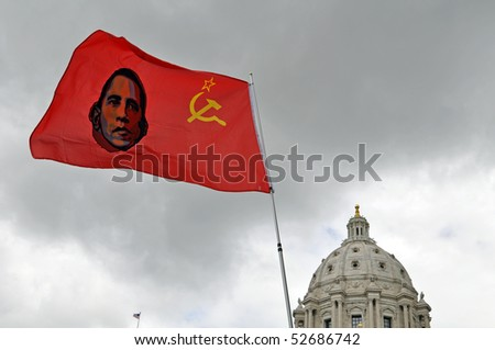 ST. PAUL - MAY 7: A political sign is waved  at the Tax Cut Rally at the state capital on May 7,2010 in St. Paul, Minnesota. - stock photo