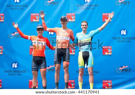 ST. PAUL, MINNESOTA - JUNE 15, 2016: Winners podium at North Star Grand Prix men's pro cycling event time trial in St. Paul on June 15 from left are Evan Huffman, champion Tom Zirbel and Aaron Beebe.  - stock photo