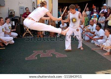 ST. PAUL, MINNESOTA - SEPTEMBER 2:  A demonstration of Capoeira at the Minnesota State Fair on September 2, 2012, in St. Paul, Minnesota.  Capoeira is an art form that combines dance, music and the martial arts. - stock photo