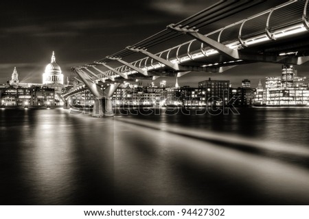St Paul's and the City of London from the south bank of the River Thames below Millennium Bridge (monochrome) - stock photo