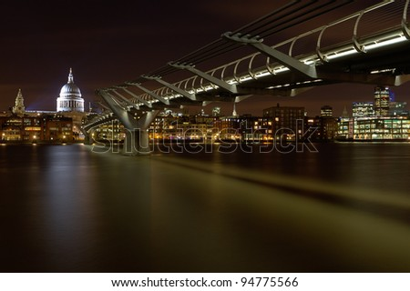 St Paul's and the City of London from the south bank of the River Thames below Millennium Bridge - stock photo