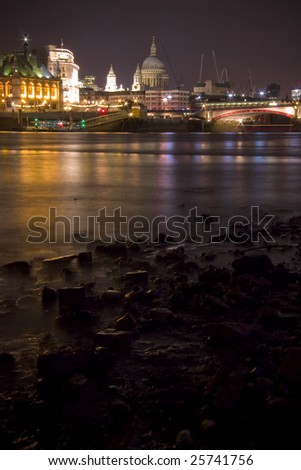 St Paul's Cathedral and City of London skyline across River Thames at night - stock photo