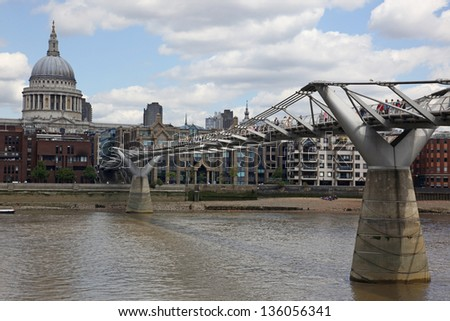 St. Paul's Cathedral and Millennium Bridge in London - stock photo