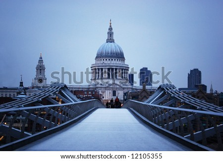 St Paul's Cathedral and Millennium Bridge in London at evening. - stock photo