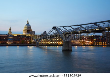 St Paul's Cathedral and Millennium bridge in London in the evening, natural colors - stock photo