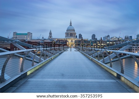 St.Paul's cathedral and Millennium bridge viewed at sunrise in London, England