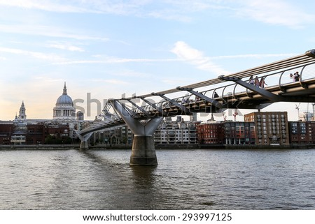 St Paul's Cathedral and Millennium Footbridge over the Thames. London UK  - stock photo