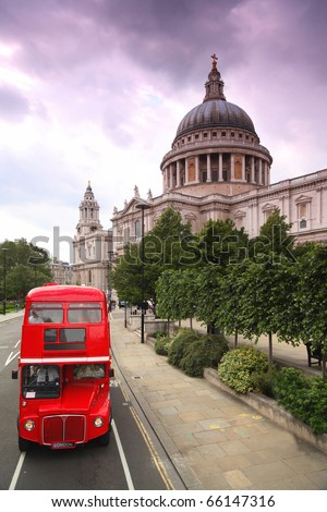 St. Paul's Cathedral and red double-decker. Cathedral was designed by court architect Christopher Wren - stock photo
