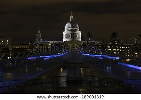 St. Paul's Cathedral and the Millenium bridge at night in London, United Kingdom. - stock photo