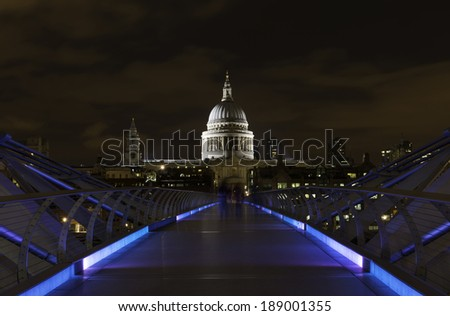 St. Paul's Cathedral and the Millenium bridge at night in London, United Kingdom.