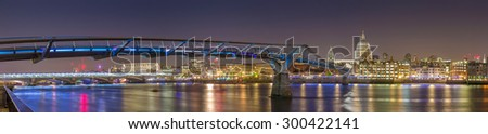 St Paul's Cathedral and the Millennium Bridge by night, London, UK - stock photo