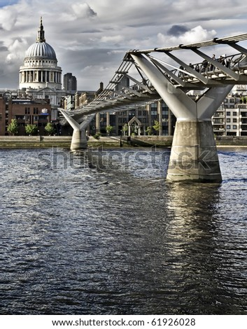 St. Paul's cathedral and the Millennium bridge, London - stock photo