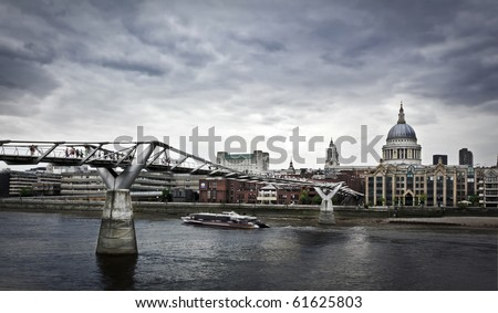 St. Paul's cathedral and the Millennium bridge (London, England). - stock photo