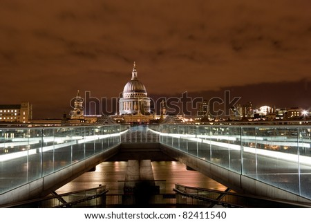 St. Paul's Cathedral at night. No construction cranes visible in image. Viewed from the Millennium Bridge over the River Thames. - stock photo
