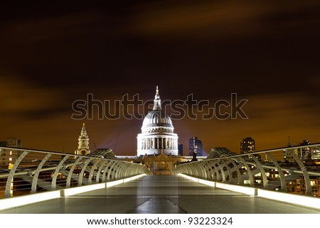 St Paul's Cathedral from Millenium Bridge across the River Thames, London - stock photo