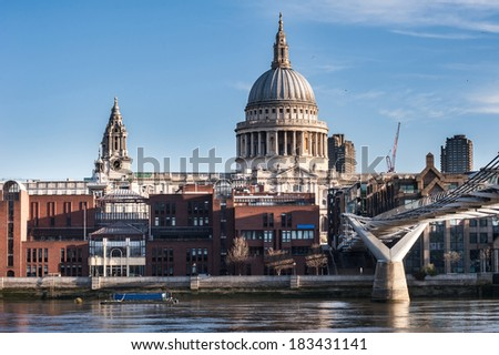 St Paul's Cathedral in Londonseen from the Millennium Bridge at sunrise on a beautiful sunny day in 2014.Available space for text on both upper sides of the image. - stock photo