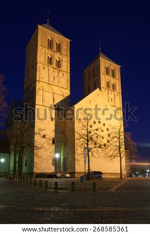 St. Paul's cathedral in Munster illuminated at night. North Rhine-Westphalia, Germany - stock photo