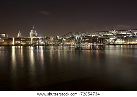 St Paul's Cathidral with Milenium Bridge in Front - stock photo