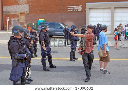 ST. PAUL - SEPTEMBER 1:  A protester confronting police at the March to the Republican National Convention in St. Paul on September 1, 2008.