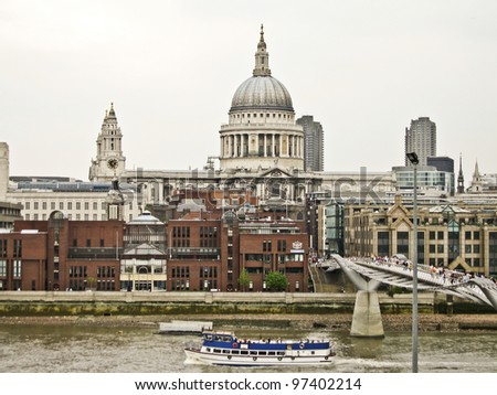 St Pauls cathedral and Millennium bridge in London - stock photo