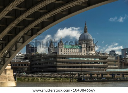 St Pauls Cathedral and the Thames as seen from under the arches of Blackfriars Station.