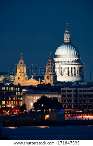 St Pauls Cathedral over Thames River at night in London. - stock photo