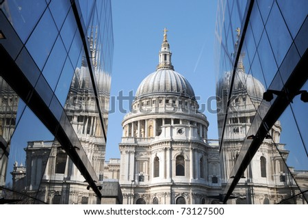 St Pauls Cathedral reflected in glass walls of One New Change in London - stock photo
