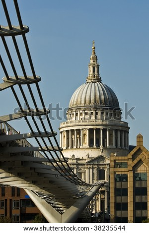 St Pauls Cathedral viewed from under the Millennium Footbridge - stock photo