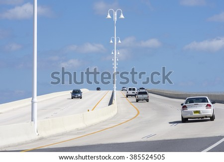 ST. PETE BEACH, FLORIDA, USA - FEBRUARY 25, 2016: Two-way traffic and a pedestrian walkway on the highway 682 concrete bridge connect St. Pete Beach and Isla del Sol on Florida's gulf coast. - stock photo