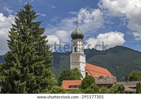 St. Peter and Paul, the Catholic parish church of Oberammergau was built in the Baroque style - stock photo