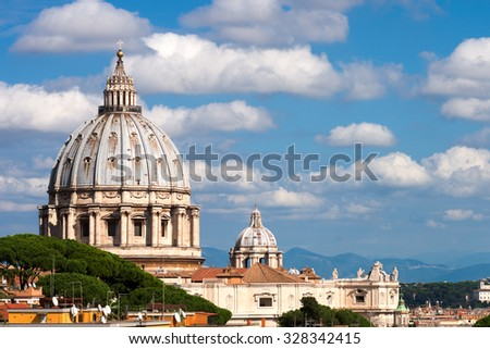 St.Peter and roofs of Rome