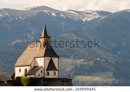 St. Peter Church in Friesach, the oldest town of Carinthia in Austria - stock photo