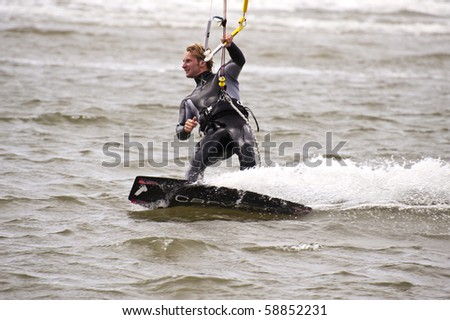 ST. PETER-ORDING, GERMANY - JULY 22: Professional kite-surfer Karsten Koschewski, Germany, demonstrates his ability on the Palmolive Kitesurf Worldcup 2010, July 22, 2010 in St. Peter-Ording, Germany