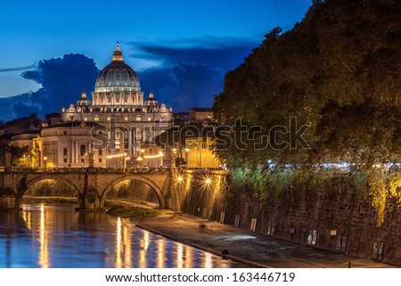 St. Peter's Basilica at night in Rome, Italy - stock photo