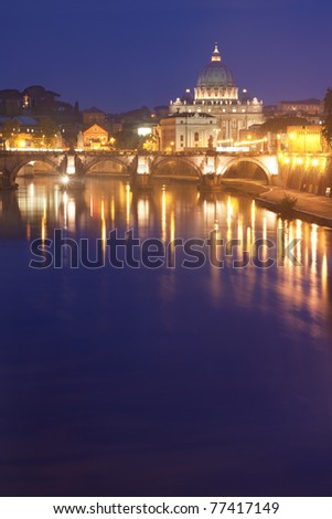 St Peter's Basilica in Rome, Italy, by night  - Tiber river on foreground - stock photo