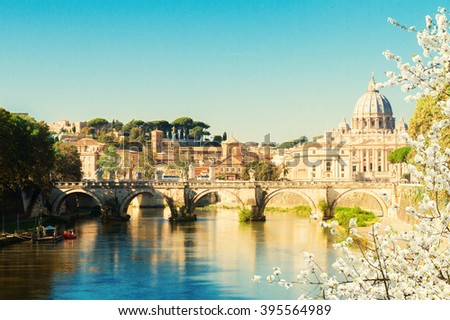 St. Peter's cathedral over bridge and river in Rome at spring, Italy - stock photo