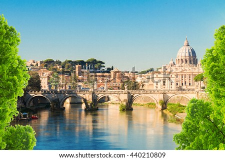 St. Peter's cathedral over bridge and river in Rome, Italy - stock photo