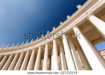 St. Peter's Square, Vatican, Rome, Italy View of the colonnade with statues of saints surrounding St. Peter's Square - stock photo