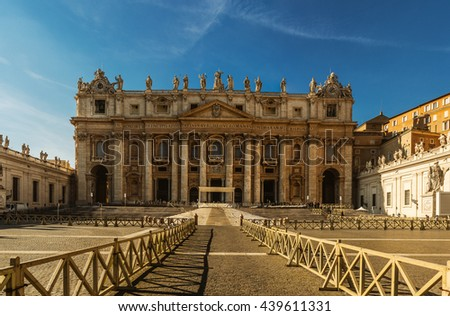 St. Peter Square is a large plaza located directly in front of St. Peter's Basilica in the Vatican City, the papal enclave inside Rome, directly west of the neighbourhood or rione of Borgo. - stock photo