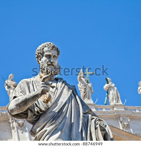 St Peter statue in St. Peter Square (Rome, Italy) with blue sky background
