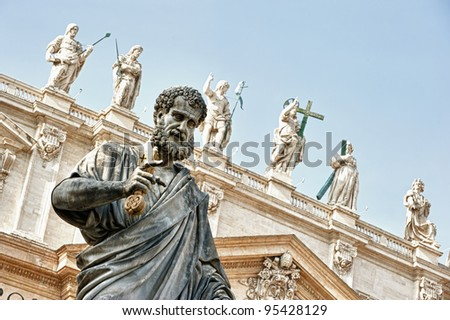 St Peter statue in St. Peter Square (Rome, Italy) with blue sky background - stock photo