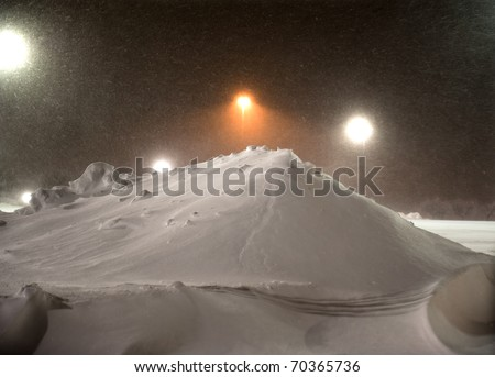 ST. PETERS, MO UNITED STATES FEBRUARY 2, 2011 - Snow continues to fall upon recently plowed parking lots during the blizzard that blanketed the U.S. Midwest. - stock photo